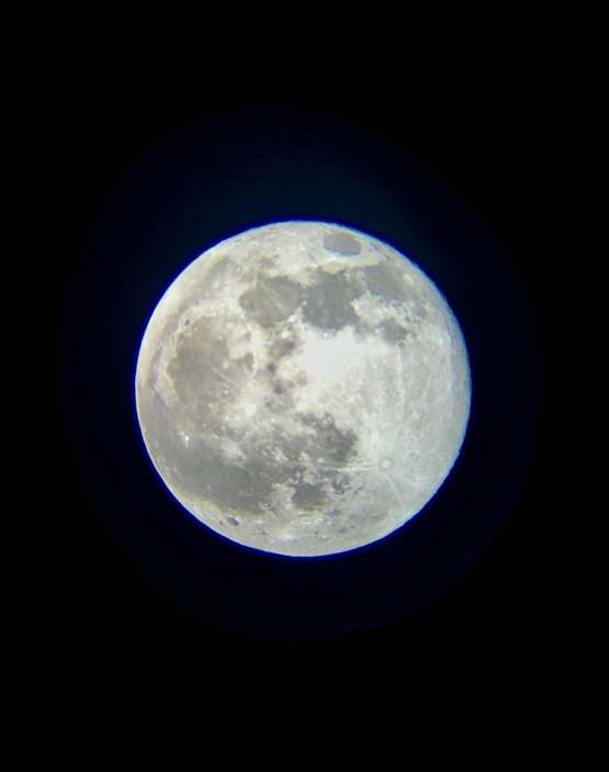 My son got a new telescope for his birthday this past week and wanted to try and get a picture of tonight's full moon. I think it's a great first attempt.