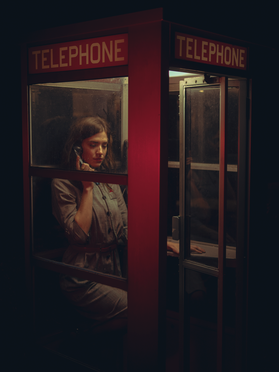 Took a photo of a friend in a phone booth. (Tried my best to make it look like a Caravaggio painting.)
