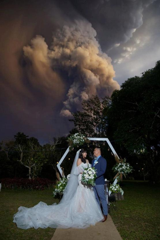 Wedding Ceremony during Taal volcanic eruption in Alfonso, Philippines.