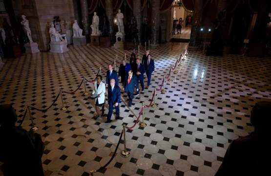 House managers chosen by Speaker Nancy Pelosi walk across Capitol Hill to deliver the articles of impeachment to the Senate chamber. 1/15/2020