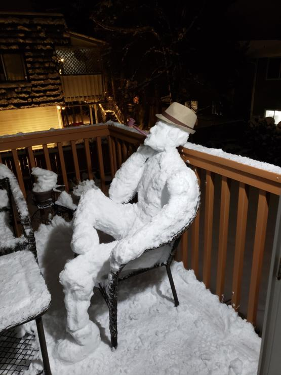 My snowman taking a break on the balcony