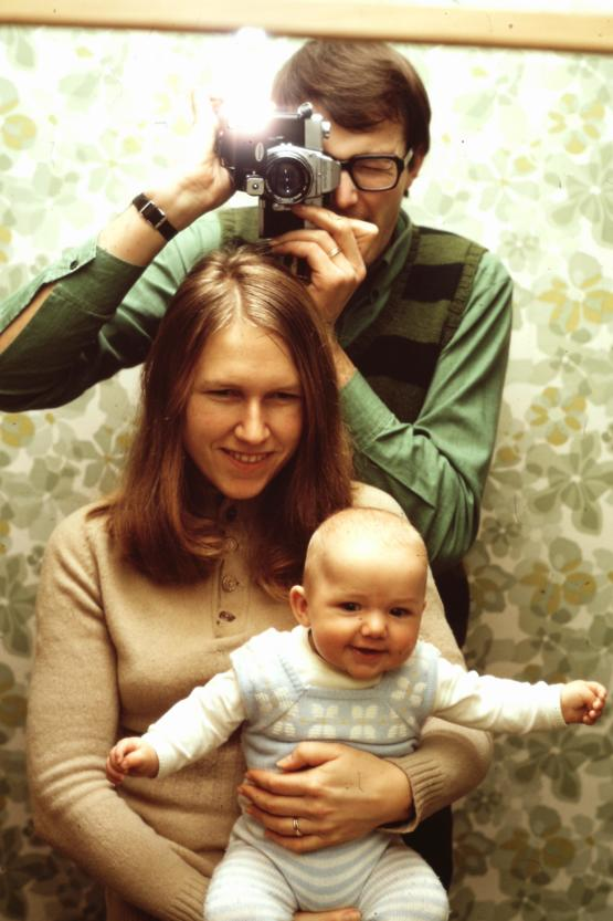 My grandfather taking a mirror selfie with my grandmother and father, early 1970s.