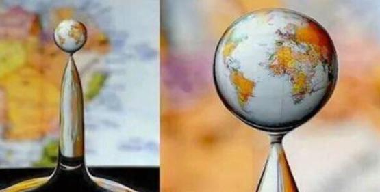 """Water droplet """"creates"""" the globe due to the nature of refraction!"""