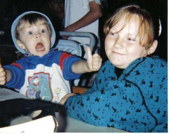 A photo of me and my sister from 1993 at chucky cheese. I saw the pizza coming as the photo was snapped