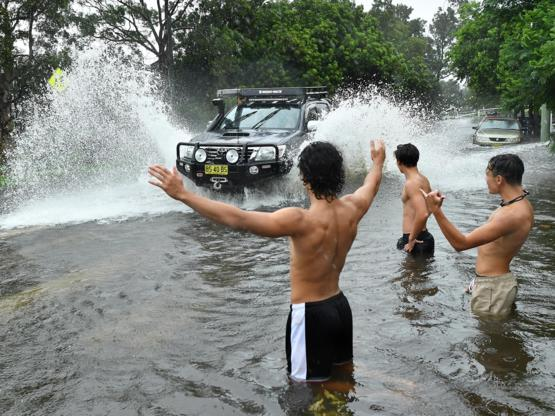 Australians celebrate in the still-rising floods
