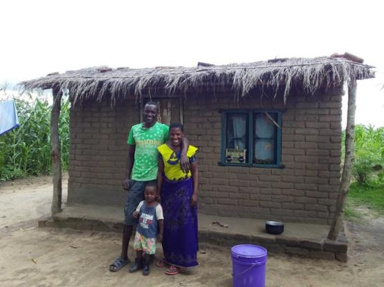 A nice guy called Kingston (left) build this house for his wife (right) and their son (middle)