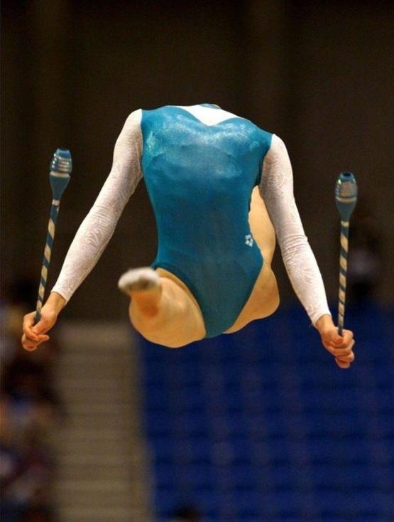 Stunning gymnastics flexibility, and a good moment for the photographer