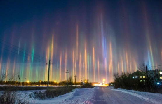Light pillars in Russia created by refracting ice crystals. Incredibly rare.