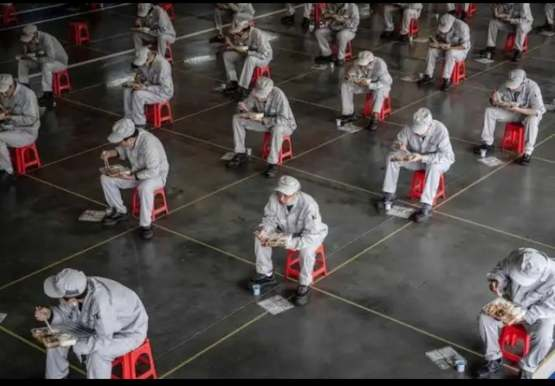 Employees eating during lunch break at a Honda auto plant in Wuhan China. 3/23/2020