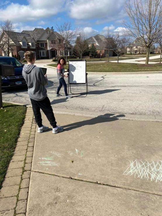 Friend's son had trouble e-learning algebra. Teacher showed up in the driveway with a white board.