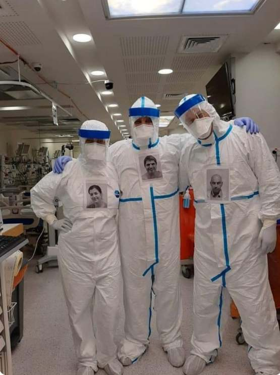 Doctors putting own pictures on PPE so patients can see who's treating them