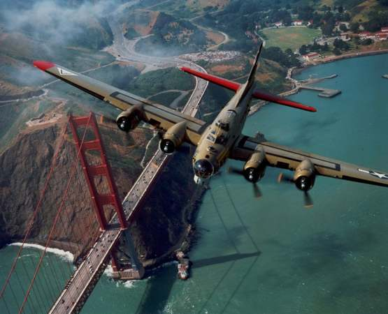 B-17 WWII bomber beautifully flying over the Golden Gate bridge.