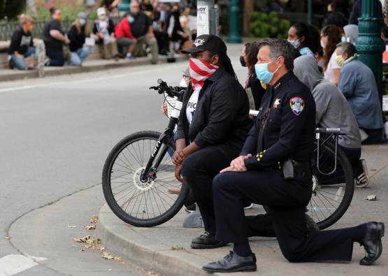 A Californian police chief taking a knee during a peaceful protest in Santa Cruz