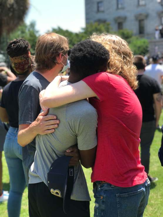 At the South Carolina state house today this young man started crying and was immediately comforted