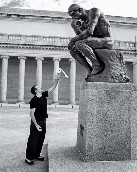 """Robin Williams offering """"The Thinker"""" a roll of toilet paper"""