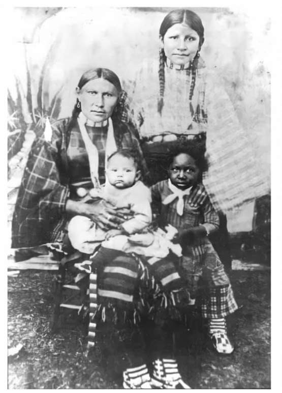Native American women with her children. One of which she adopted after being freed from slavery.