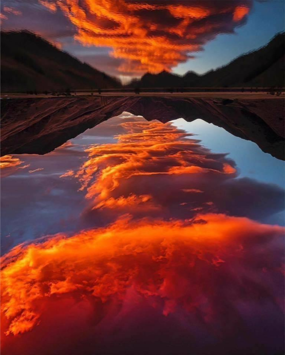 Lake reflects the red clouds