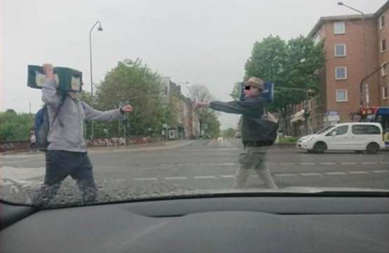 Two germans carrying beer meet at a traffic light.