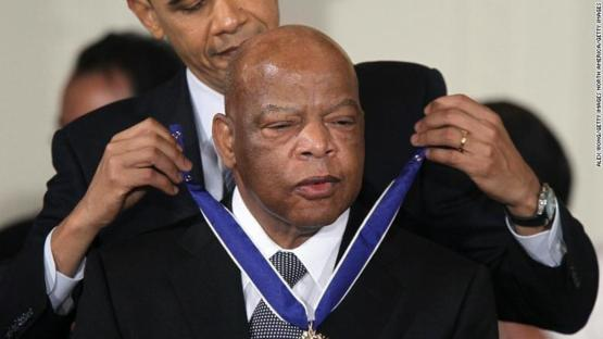 Barack Obama awarding the presidential medal of freedom to the late representative John Lewis