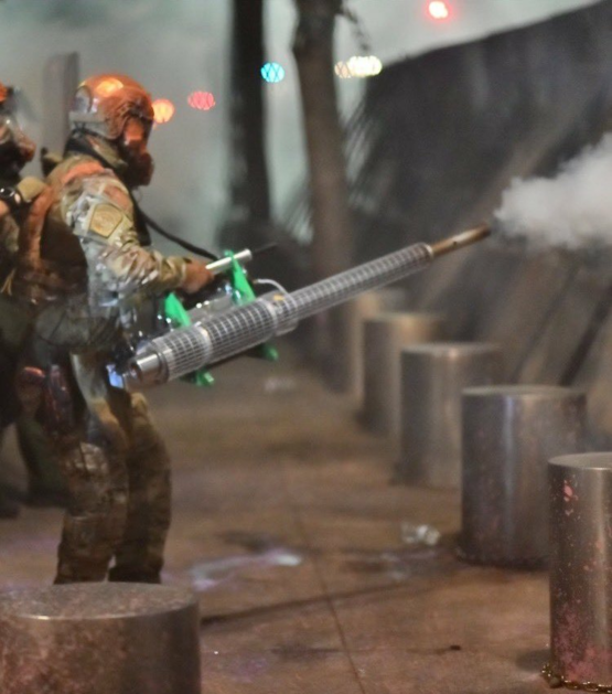 Federal Solider using pesticide sprayer to spray US, Portland protestors with unknown chemicals