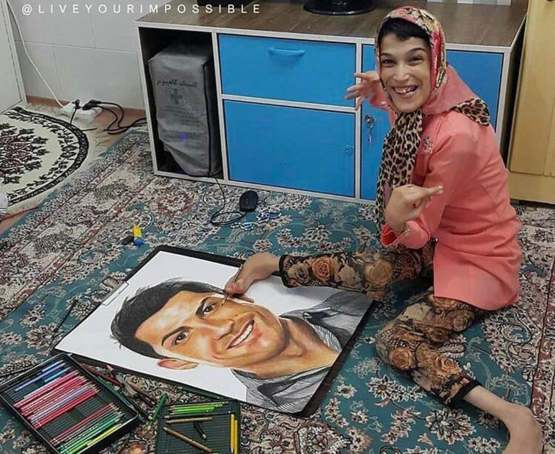 Disabled Iranian artist Fateme Hamami draws the portrait of Christiano Ronaldo using her feet.