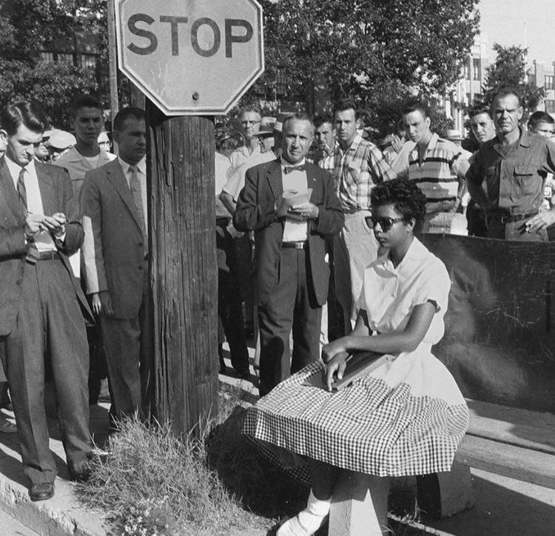 15 yr old Elizabeth Eckford facing angry mobs on the first day of school during desegregation,1957