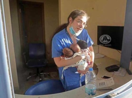 Nurse in Lebanon trying to save 3 babies after the hospital she work at was half destroyed.
