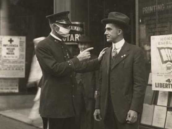 San Fransisco police officer scolding a man for not wearing a mask during the 1918 influenza pandemi