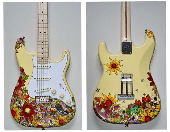 I painted a Jimi Hendrix inspired guitar for my boyfriend