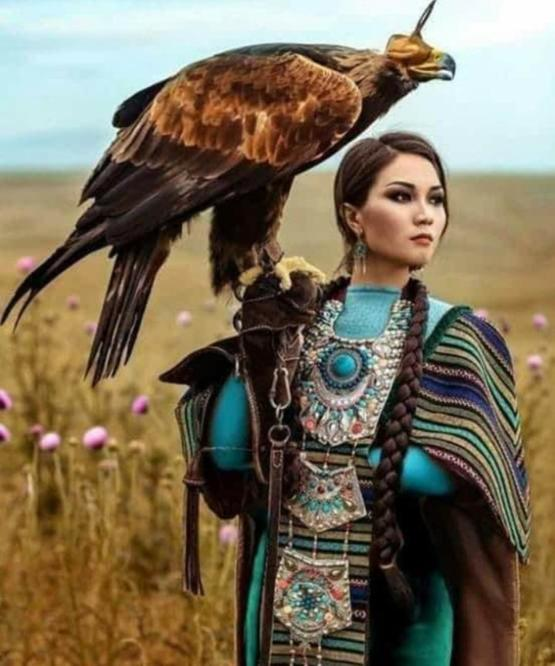A Kazakh Eagle huntress with her Golden eagle.