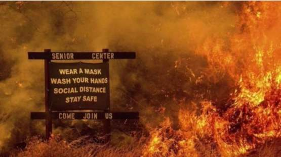 COVID-19 Sign next to wildfire makes for a great dystopia picture