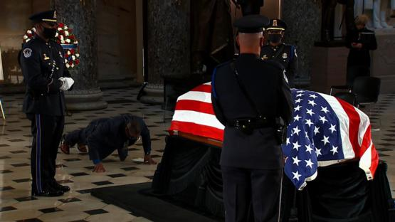 RBG's personal trainer pays final respects by doing push-ups as RBG lies in state at US Capitol