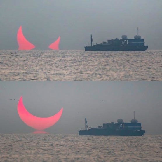 """Devils Horns"" sunrise captured in Qatar, during a partial eclipse during sunrise ????"