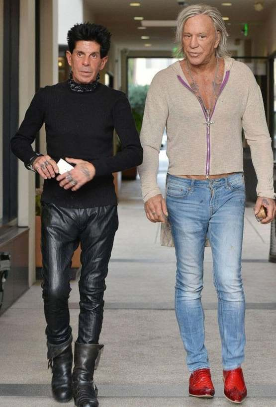 This photo of Mickey Rourke and friend looks like it could be from the next Zoolander on 20 years