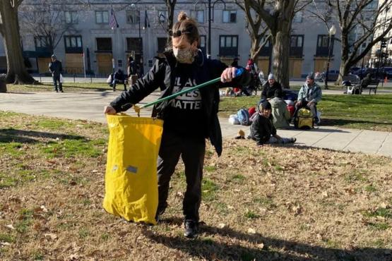 Veterans from a local organization picking up trash from Trump rioters in D.C.
