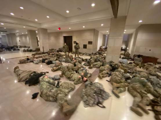 Soldiers getting a rest in the Halls of Congress