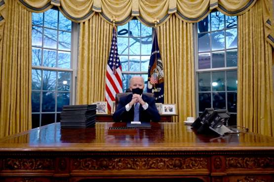 His first photo in the Oval Office