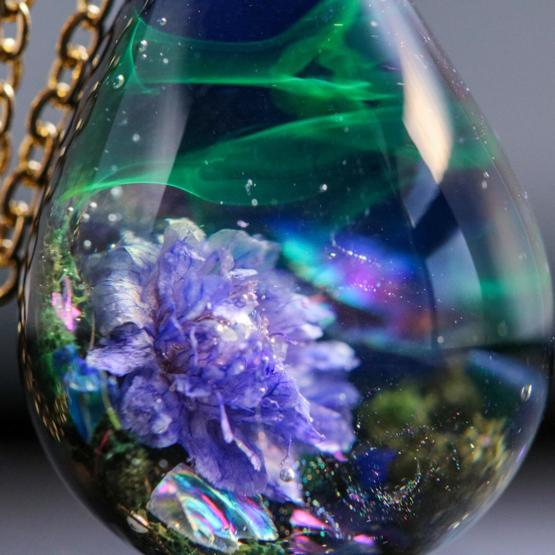 My job is to create mini worlds. Here's a closeup of one of my aurora pendants!