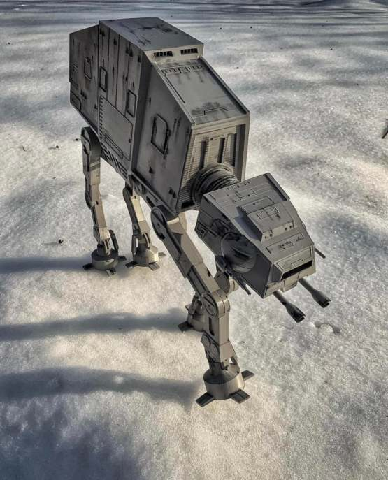 My dad 3D printed an AT-AT (18 in height) and took advantage of snow in the backyard.