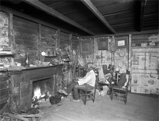 One of the last known survivors of the Atlantic slave trade, Cudjoe Lewis at his home in early 1930s