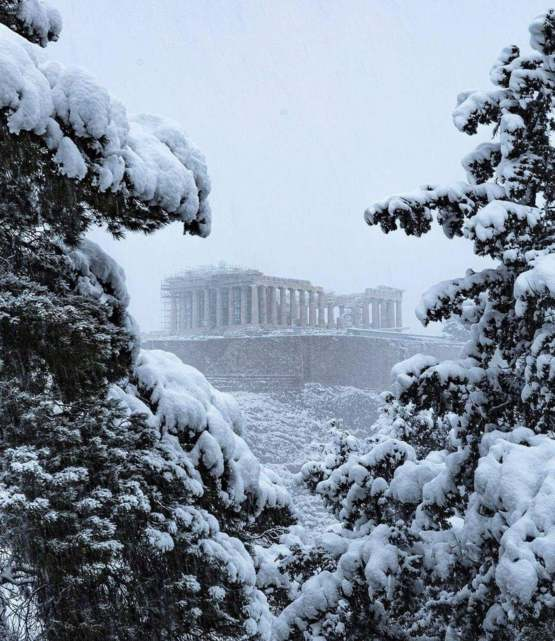 Acropolis of Athens with snowfall from this year.