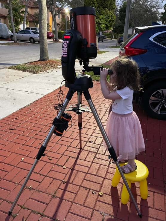 My 3 year old looking at the moon through a telescope, for the first time ever