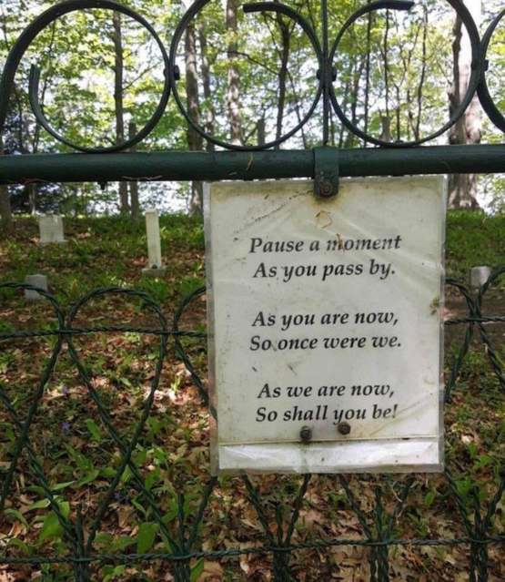 This sign in an old graveyard