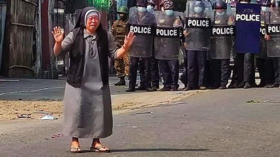 A Burmese nun pleading the police to stop their brutality. She freed 100 protestors from the police.