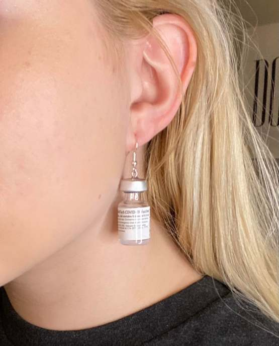 Friend was able to get me a bunch of empty Pfizer vaccine bottles. Turned them into earrings!