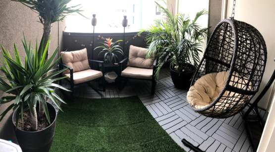 Turned our ugly concrete balcony into a lush tropical getaway.