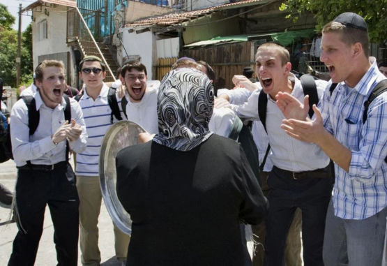 Israeli Settlers making fun of a Palestinian woman evicted from her home in Sheikh Jarrah