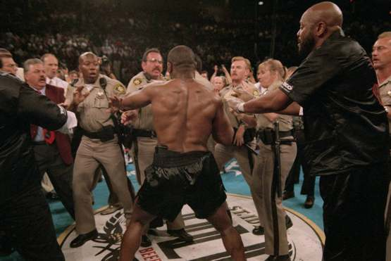 Las Vegas police facing Mike Tyson after he'd just bitten Holyfield's ear off (1996)