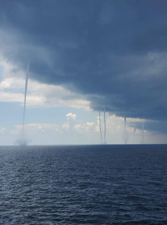 Multiple waterspouts in Gulf of Mexico off the Louisiana Coast.