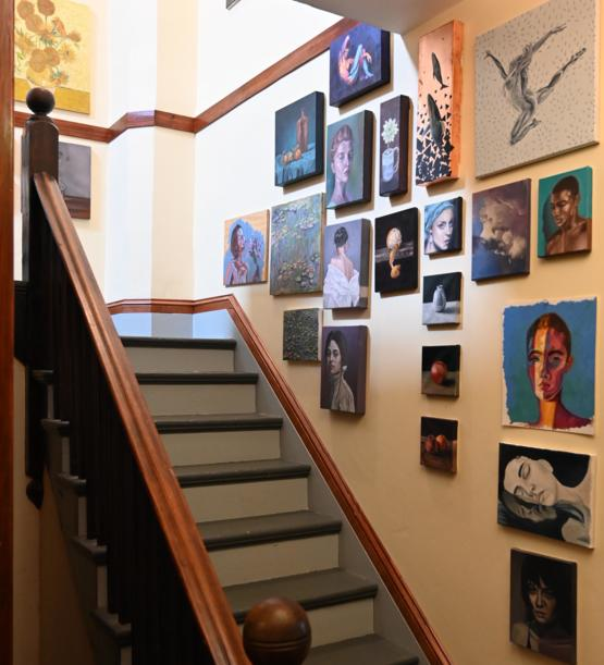 I filled my stairwell with some of my learning-to-paint-during-covid art